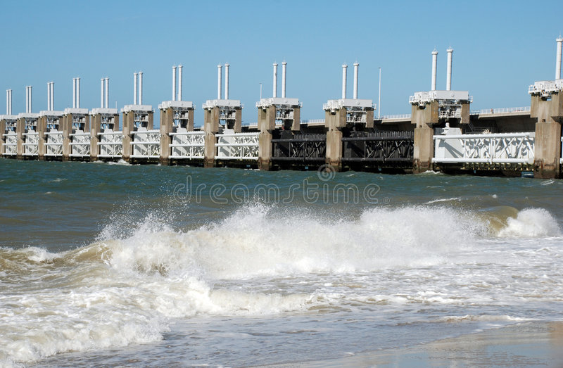 Storm barrier in the Netherlands. Storm barrier stormvloedkering in the Oosterschelde, that can be closed when floods occur: the low land under sea level will be royalty free stock image