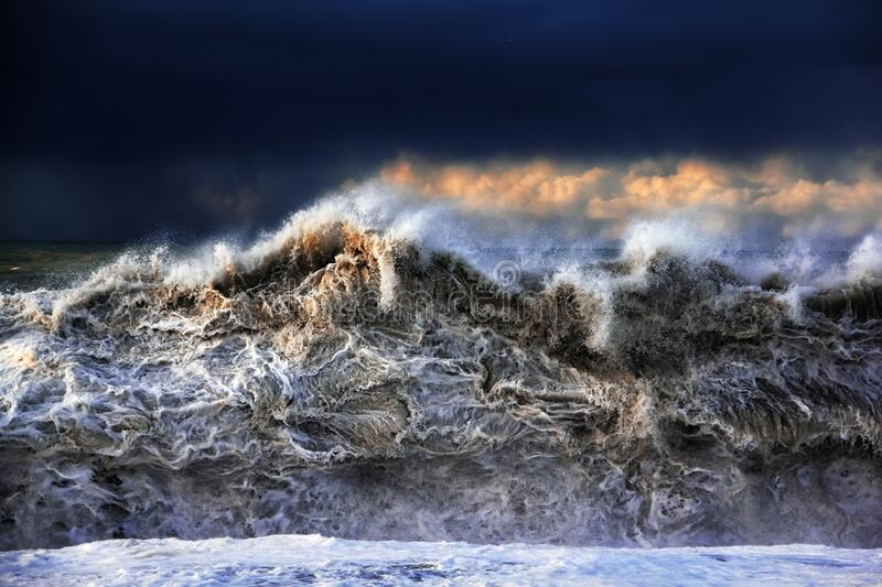 Storm on Black sea. Powerful splashing waves. Dramatic sky royalty free stock photography