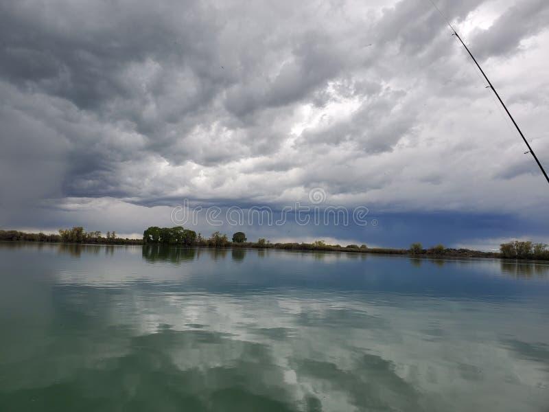 Storm brewing at mud lake stock image