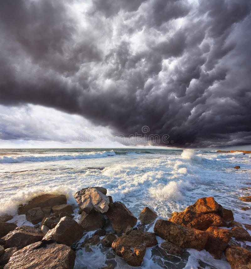 The storm cloud over the raging surf stock photo