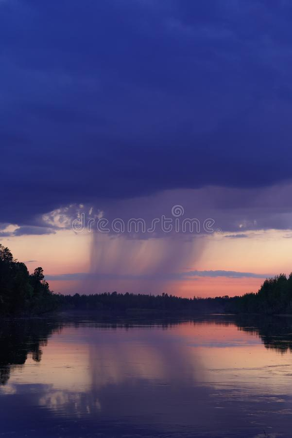 Storm cloud over the river stock image