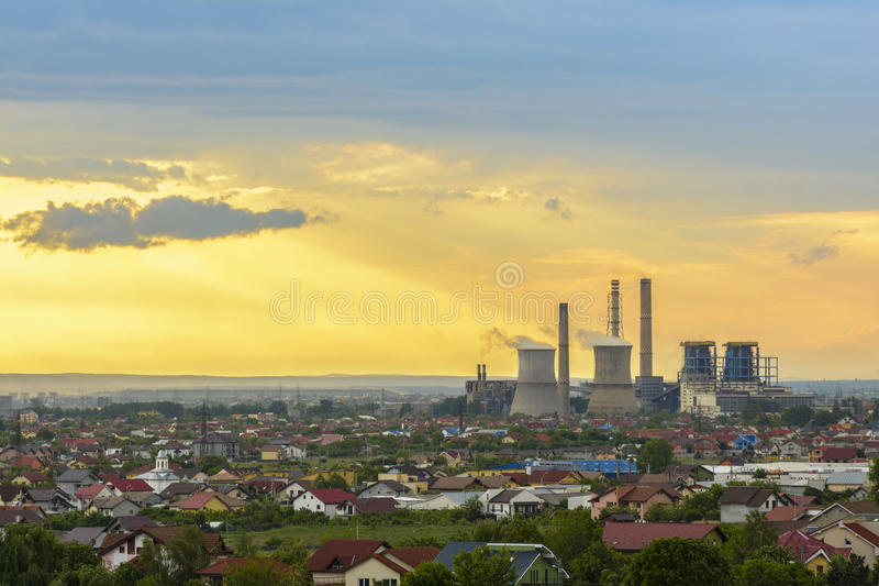 Storm clouds above Craiova city. Storm clouds at sunset, above the thermal plant in Craiova city, Romania royalty free stock photo