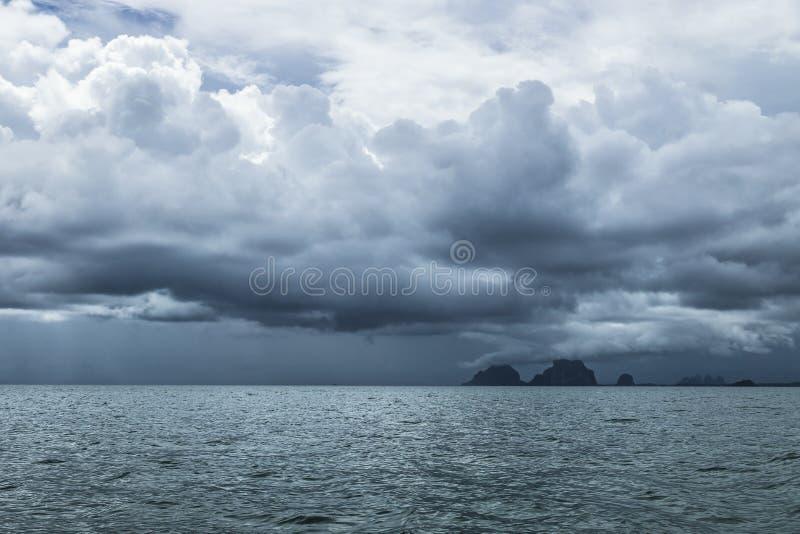 Storm clouds at Amandan sea, Thailand. Dark blue storm rain cloudscape at Amandan sea near Koh Mook, Thailand stock images