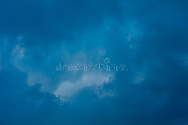 Storm Clouds background. Heavy massive stormy clouds with no sunlight royalty free stock images