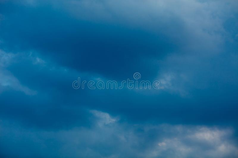Storm Clouds background. Heavy massive stormy clouds with no sunlight stock photo