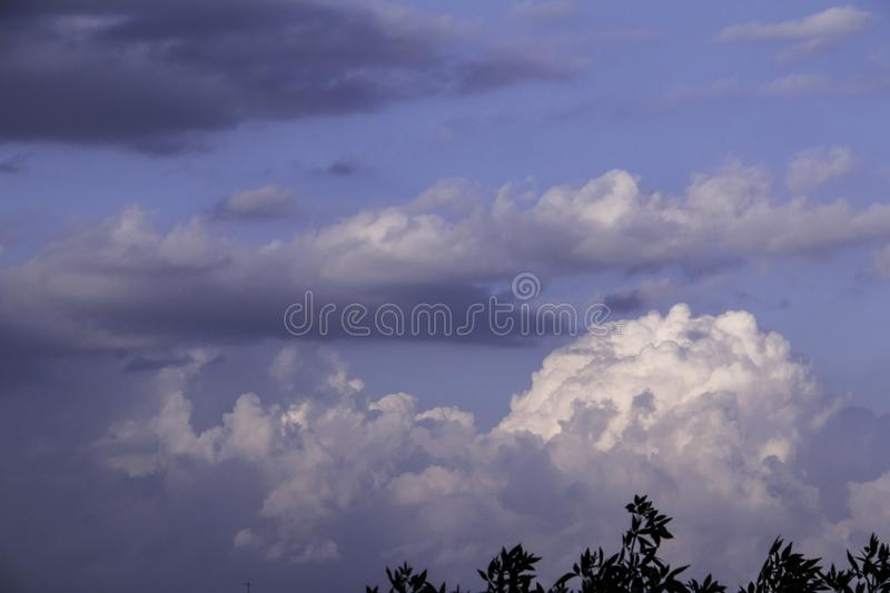 Storm clouds on blue sky stock photo