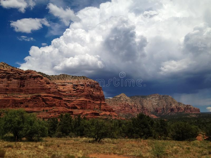 Storm clouds build behind the Sedona red rocks stock images