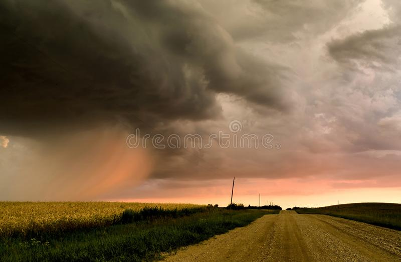 Storm Clouds Canada. Rural countryside Prairie Scene Sunset stock photo