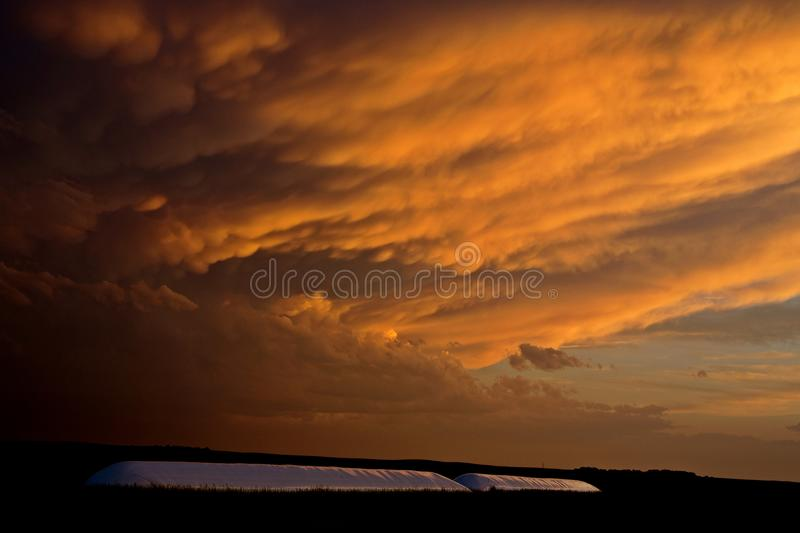 Storm Clouds Canada. Rural countryside Prairie Scene Sunset royalty free stock photo