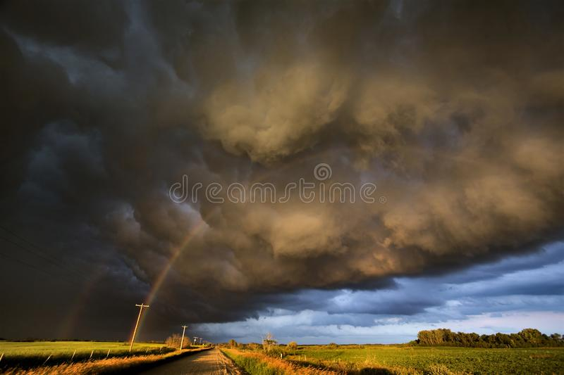 Storm Clouds Canada. Rural countryside Prairie Scene Sunset stock image