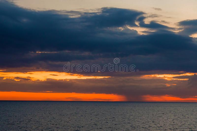 Storm clouds coming over sea. Top view Aerial photo from flying drone over village. op view beautiful Sunset.Sunrise with cloud rainy storm stock photos