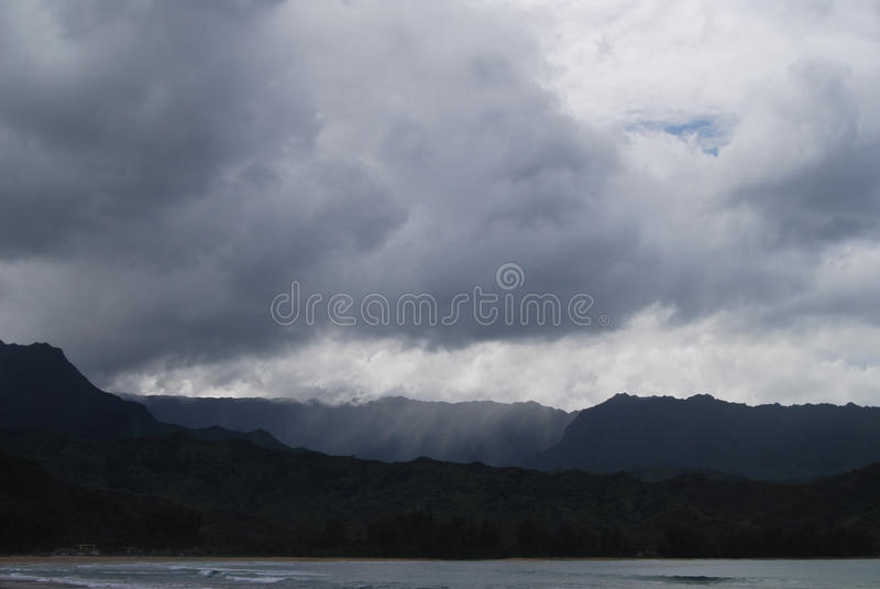 Storm Clouds Dump Rain on Mountain stock photos