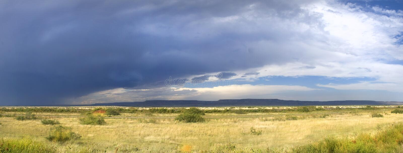 Storm clouds forming in New Mexico along Route 66. Dark storm clouds forming in New Mexico along the famous Route 66 royalty free stock images