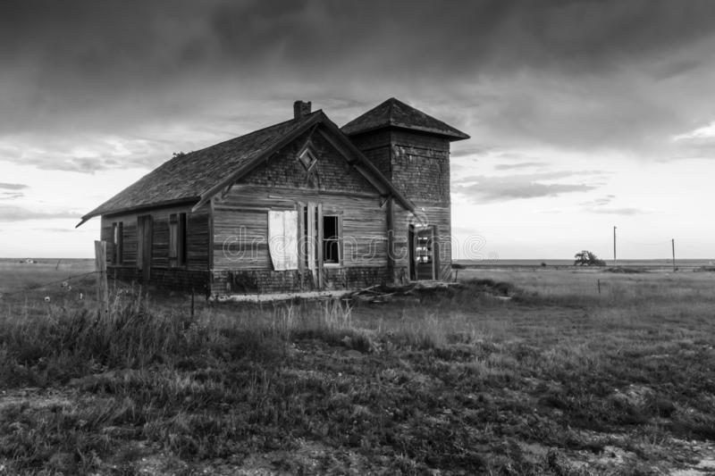 Old Abandoned House in New Mexico, Black and White. Storm clouds forming over an old abandoned farm house in Northern New Mexico. Black and white photo royalty free stock photos