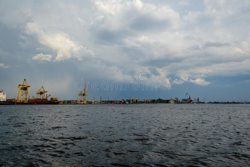 Storm clouds forming over Riga cargo shipping port on river Daugava royalty free stock photos