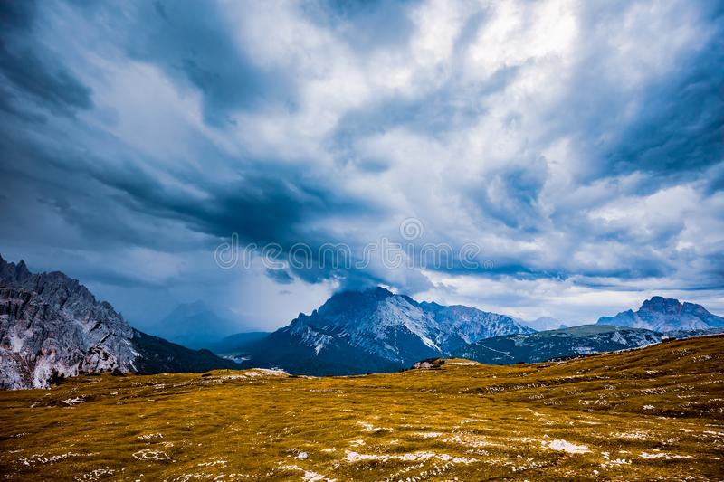 Storm clouds Italy Dolomites. Sun stock image