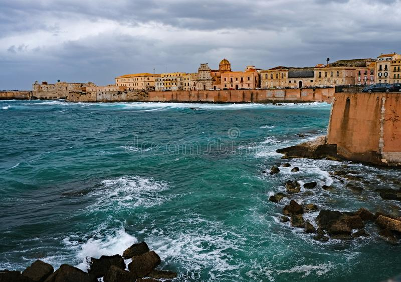 Storm clouds moved over the Island of Ortigia in Syracuse, Sicil. Y, Italy, on February 23, 2018. A `beast from the east` weather front from Siberia produced the stock photo