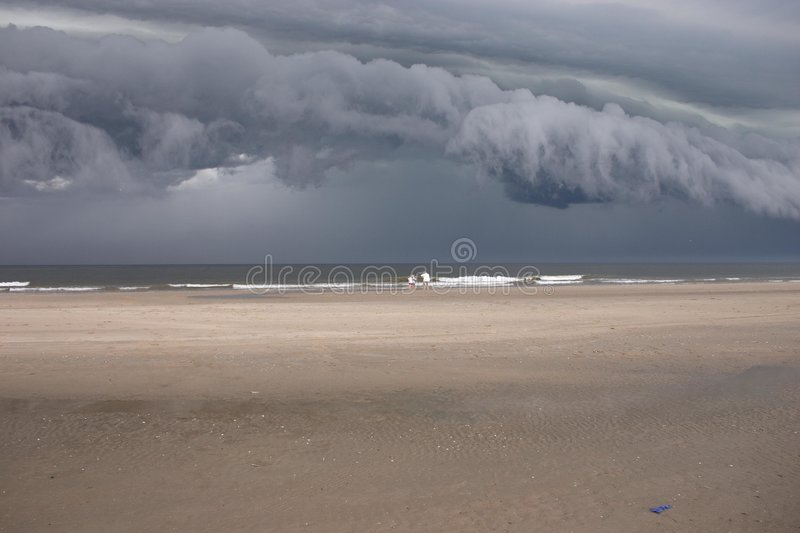 Download Storm clouds over beach stock photo. Image of oppressive - 192152