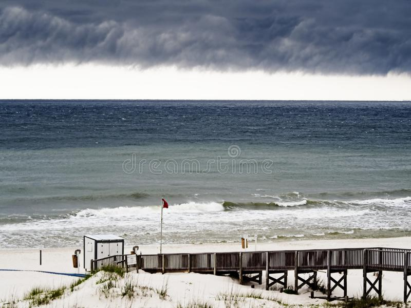 Storm Clouds Over Beach and Wooden Walkway 2 royalty free stock images