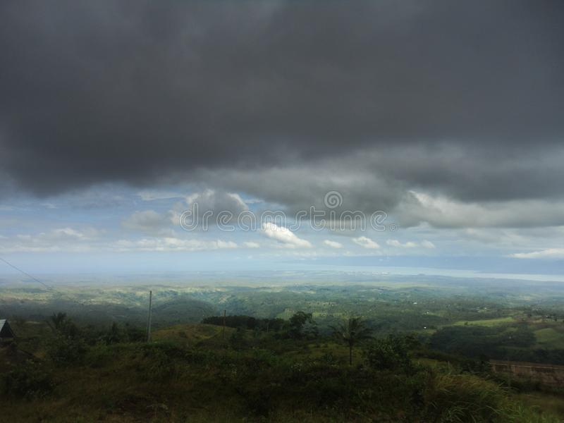 Storm clouds over Bokor Mountains in Kampot, Cambodia royalty free stock photography
