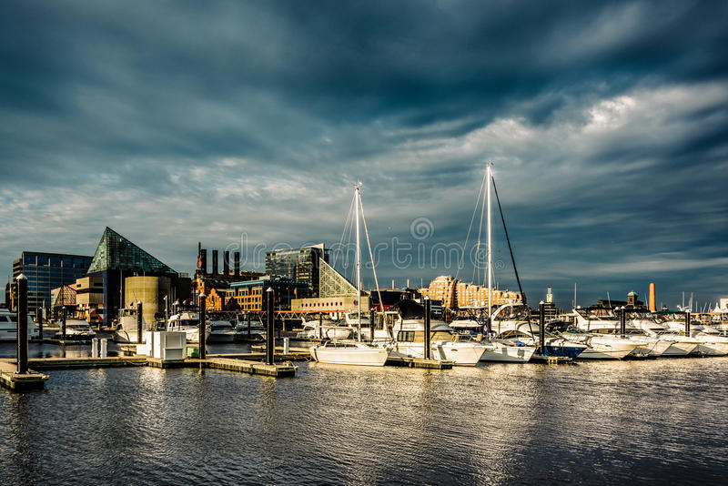 Storm clouds over a marina at the Inner Harbor, Baltimore, Maryland. stock photos