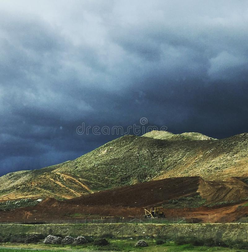 Storm clouds over the mountains at Banning California royalty free stock images