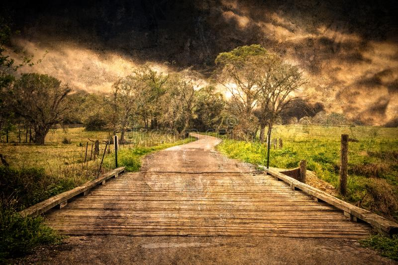 Storm Clouds Over Texas Country Road and Bridge stock image