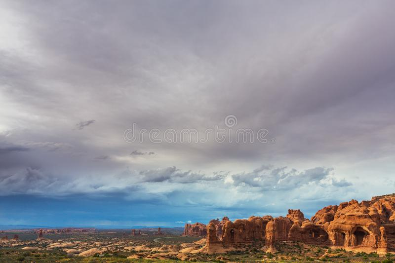 Dramatic storm clouds and rain in Arches National Park desert. Storm clouds and rain in Arches National Park, Utah, USA stock image
