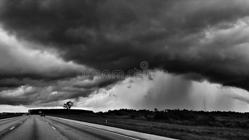 Thunderstorm clouds and rain showers in black and white. Thunderstorm clouds royalty free stock photography