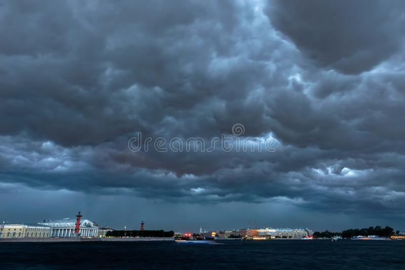 Storm clouds in Saint Petersburg. RUSSIA, SAINT PETERSBURG - AUGUST 18, 2017: Storm clouds in Saint Petersburg. The Palace bridge. Vasilievsky island royalty free stock images