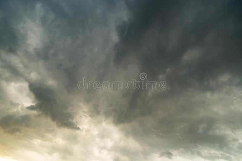 Storm clouds in the sky at sunset as background stock photo