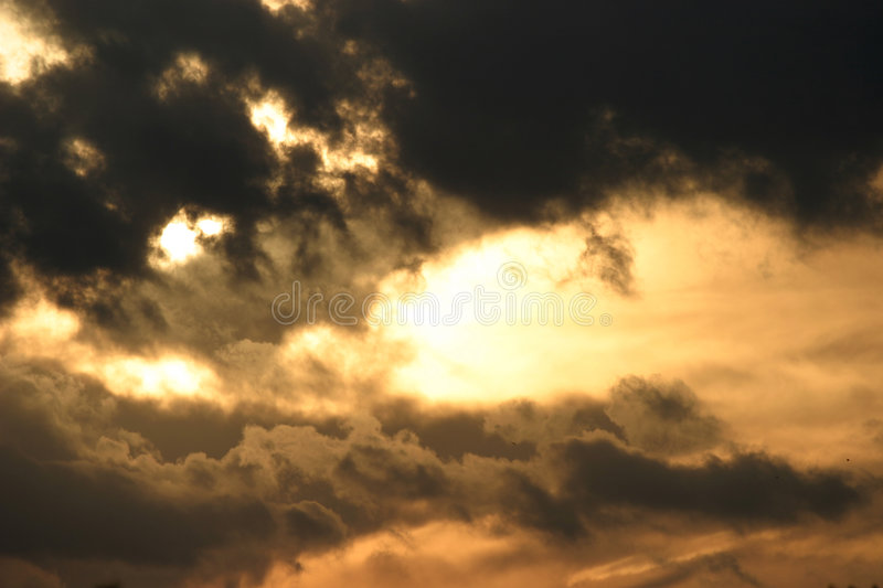 Storm clouds at sunset stock images