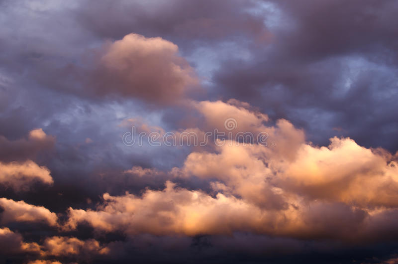 Storm clouds in the sunset light. In the summer royalty free stock photo