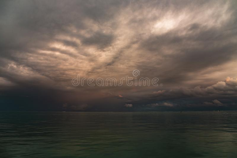 Storm clouds at sunset in the Pacific ocean royalty free stock photo