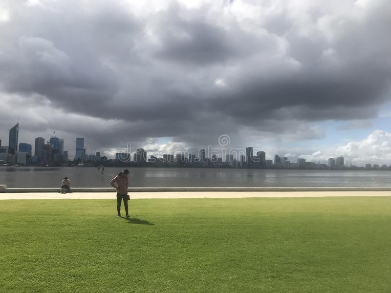 Storm coming perth city by swan river royalty free stock photography