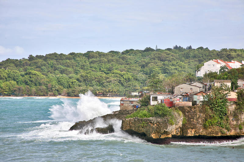 A storm coming. Poor Quarter, located right on the ledge, of the Atlantic coast in Sosua, Dominican Republic. Poor huts, shacks nestle right next to an excellent royalty free stock image