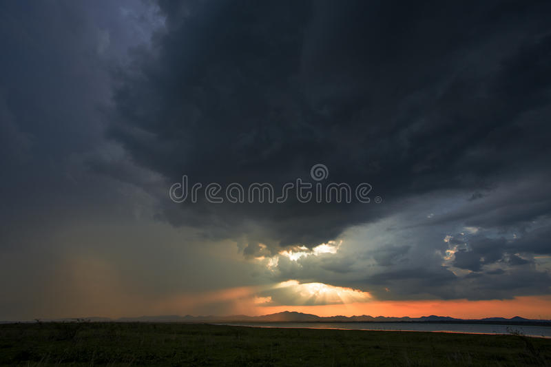 A storm is coming rain cloud are over the mountain and lake on the twilight time. stock photo