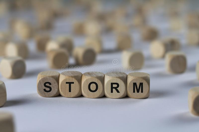 Storm - cube with letters, sign with wooden cubes royalty free stock images