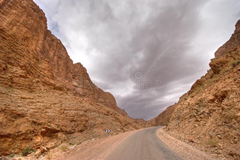 Storm in desert valley stock photos