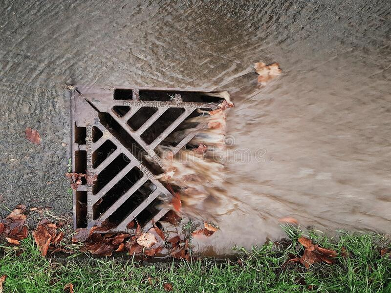 Storm drains Flooding Autumnal leaves. Storm drains Flooding blocked drains with Autumnal leaves royalty free stock photos