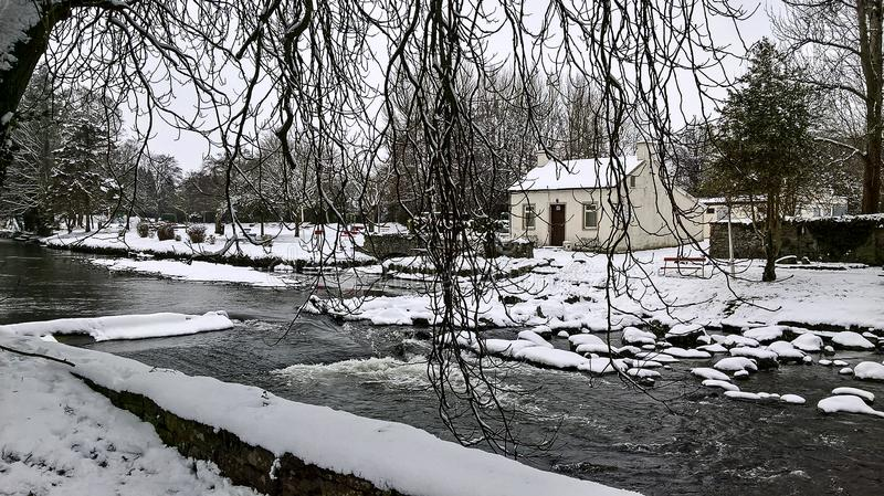 03/03/2018 Storm Emma in Ireland. Glimpse of River Dalua in the town of Kanturk, County Cork stock image