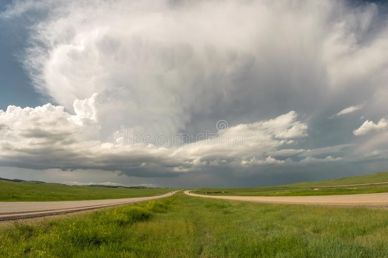 A supercell thunderstorm over the highway in South Dakota. This storm with explosive convection developed over the Black Hills in South Dakota and drifted royalty free stock images