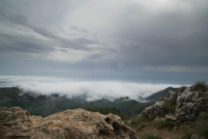 Storm front from mountain top. A view of a storm from moving in from a mountain top in southern Spain stock photography