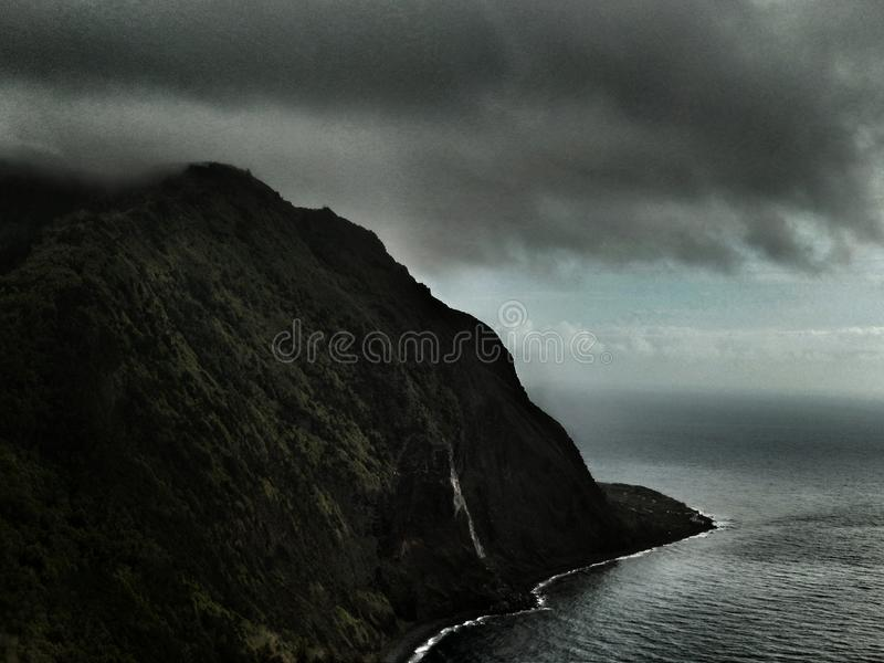 Storm Gathers over Cliffs in the Azores stock photography