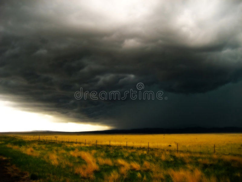 Storm On The Horizon V1. This beautiful shot of a Storm on the Horizon was captured just North of Las Vegas New Mexico. I was racing south to beat the storm as stock images