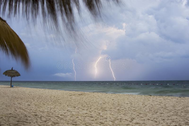 Storm and lightning on the beach stock image