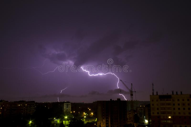 Storm and lightning in the night sky of Chelyabinsk stock photography