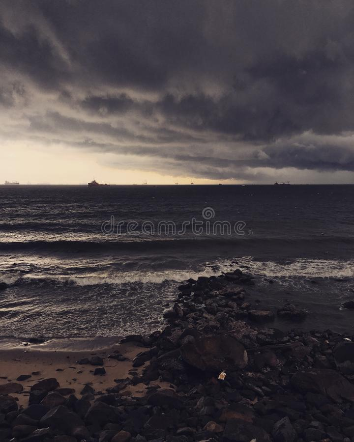 Storm off shore stock photography