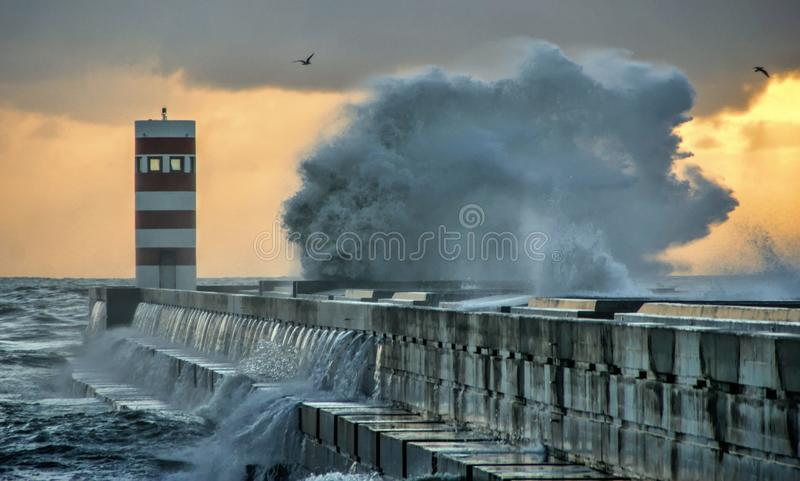 Storm in Oporto lighthouse stock photo