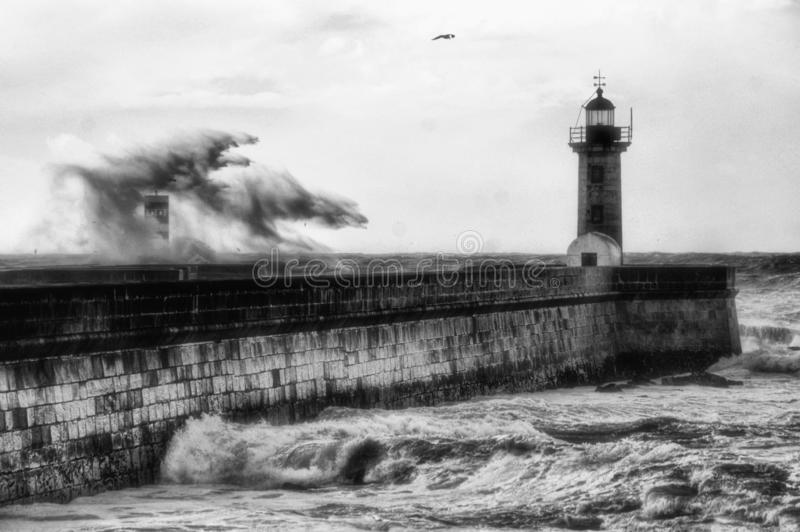 Storm in Oporto lighthouse stock image